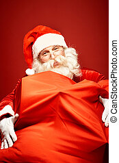 Generous Christmas - Portrait of happy Santa Claus with...