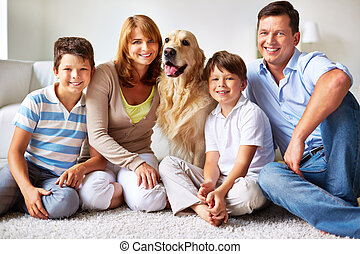 Family members - Portrait of happy father, mother and kids...