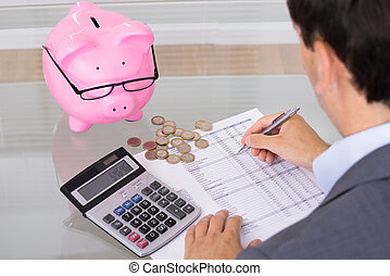 Man calculating savings and costs Over the shoulder view