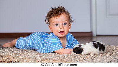 Baby boy playing with puppy - 7 months old baby boy playing...