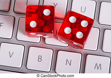 Online gambling concept - Dices and computer keyboard...