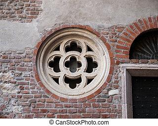 rose window - The rose window in the brick wall