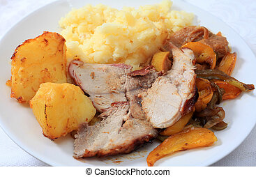 Roast pork dinner with  potatoes and sauteed peppers