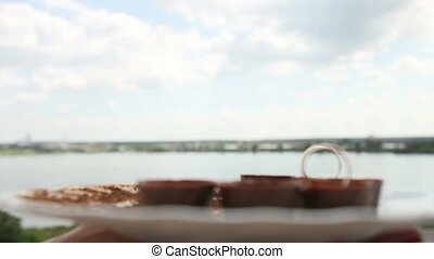 rings on the chocolate candy in a landscape pond city and...