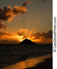 Tropical sunrise at Lanikai Beach, Oahu, Hawaii.