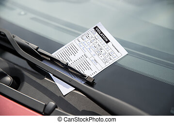 Parking Ticket On Car - Close-up of parking ticket on cars...