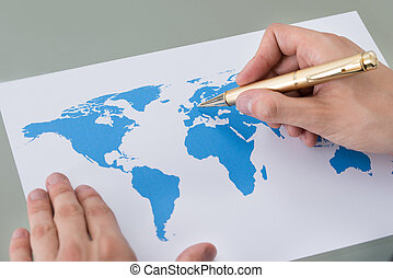 Businessman Marking Places On World Map - Cropped image of...