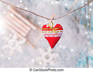 Christmas hearts hanging on wooden background