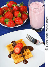 Waffle with strawberry and chocolate and a milkshake