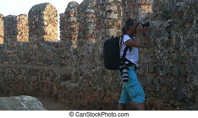 Photographer working on historical castle