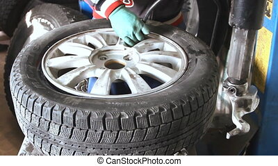 Mechanic inflating car tire closeup - Volgograd u2013...