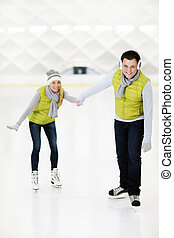 Happy couple ice skating - A picture of a happy couple in...