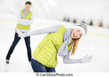 Cheerful couple in the skating rink - A picture of a happy...
