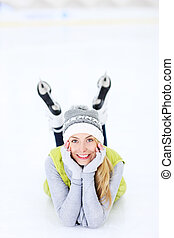 Cheerful woman lying on a skating rink - A picture of a...