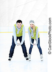 Cheerful couple on the skating rink - A picture of a happy...