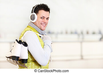 Cheerful man on a skating rink - A picture of a happy man on...