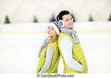 Romantic couple on the skating rink - A picture of a happy...