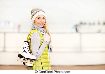Cheerful woman on a skating rink - A picture of a happy...