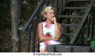 Sad woman sitting on the stairs