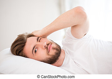 Young man waking up