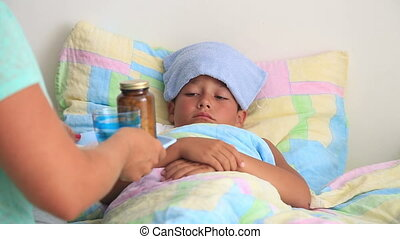 Sick child - Mother taking care of sick child