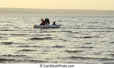 Two men fishing together in a boat - Two mans fishing...