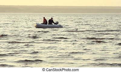 Two mans fishing together in a boat
