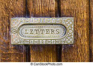 Letter Box - Close up of an ornately patterned polished...