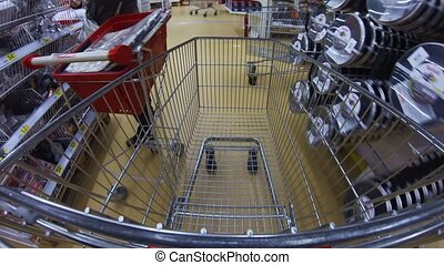Moving cart in a supermarket - MOSCOW, RUSSIA - SEPTEMBER...