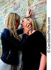 women flirting - two beautiful women flirting. rusty...