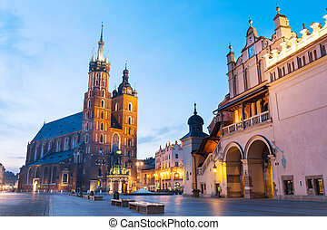 Sukiennice and St Marys Church at night in Krakow, Poland...