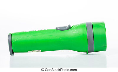 Green flashlight isolated with white background