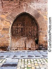 Vintage  double door in old arch