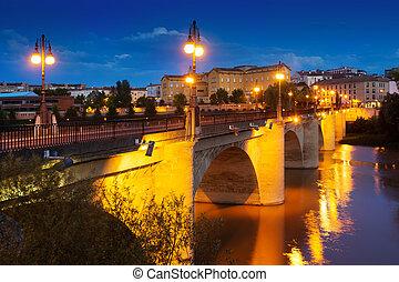 Old bridge over Ebro river in night. Logrono, Spain - Old...