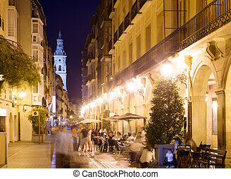 night street with restaurants in old spanish city