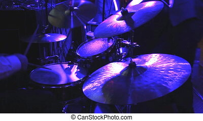 drummer playing on drum set