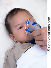 Little boy with spacer - 5 months old baby with respiratory...
