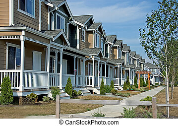 Row of Newer Townhouses - This is a newer neighborhood with...
