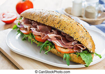 Prosciutto with rocket on sesame baguette - Prosciutto with...