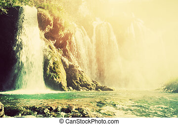 Waterfall in forest. Crystal clear water. Vintage -...