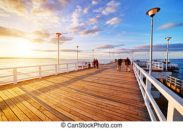 Beautiful retro pier at sunset. Gdansk Brzezno, Poland -...