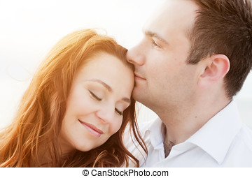 Young happy couple in love. Romantic moment on the beach in...