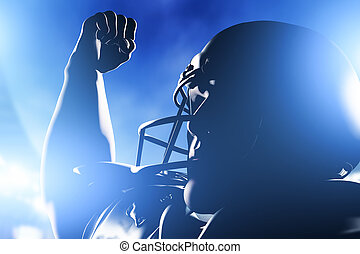 American football player celebrating score and victory Night...