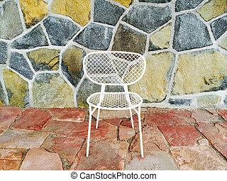 White chair on colorful tile background