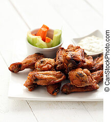 Chicken wings with sauce and vegetables - Grilled chicken...