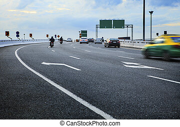 moving passenger car and motorcycle on bridge way crossing...