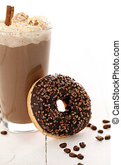 Ice coffee with whipped cream and donut with glaze on a...