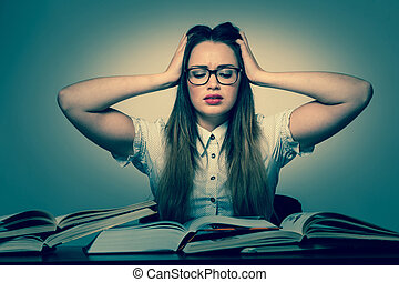 Stressed asian caucasian woman student learning in tons of...
