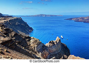 Cliff and rocks of Santorini island, Greece. View on Caldera...