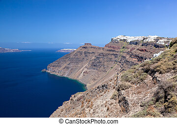 Imerovigli town on the highest cliff of the caldera,...